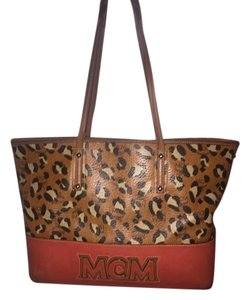 MCM Tote in Brown, black, and red.