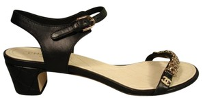 Chanel Insole Is Quilted Black with gold accents Sandals