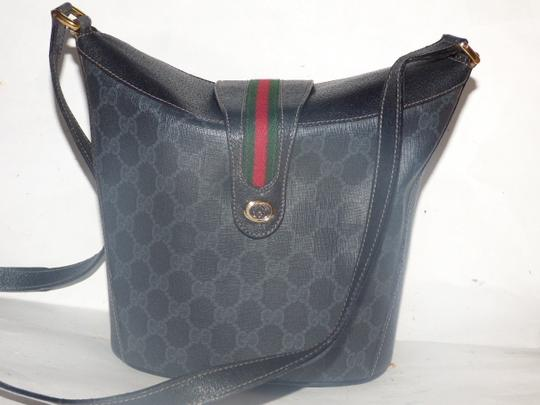 Gucci Equestrian Accents Bucket Rare And Unique High-end Bohemian Mint Condition Satchel in black leather & grey/black large G print coated canvas