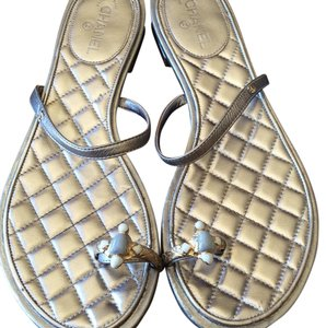 Chanel Pewter/ silver metalic with gold chanel logo on strap Sandals