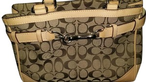 Coach Wristlet in brown /leather