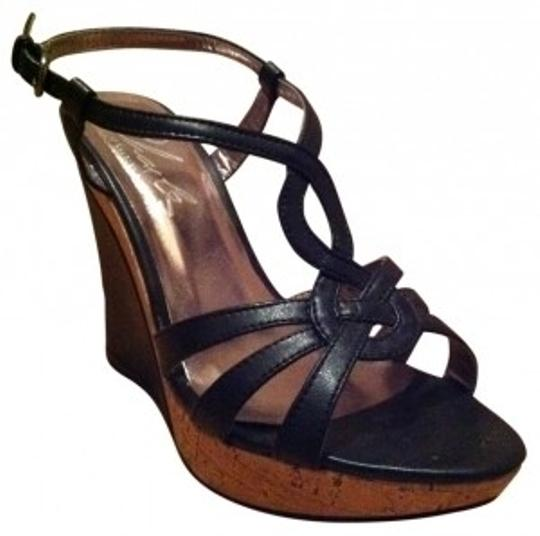 Preload https://img-static.tradesy.com/item/18858/charles-by-charles-david-black-lustre-faux-leather-with-cork-wedges-size-us-65-0-0-540-540.jpg