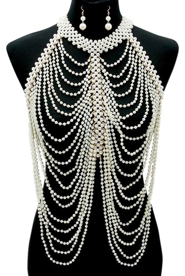 Preload https://img-static.tradesy.com/item/18887212/cream-gold-elegant-multilayered-draped-pearls-body-chain-and-earrings-necklace-0-1-540-540.jpg