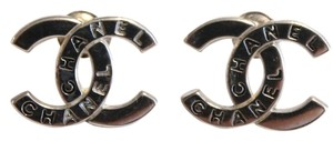 Chanel Pierced Stud Earrings with interlocking CC design engraved with chanel