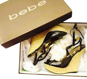 bebe Wedge Heels Size 6 Black & Gold Pumps