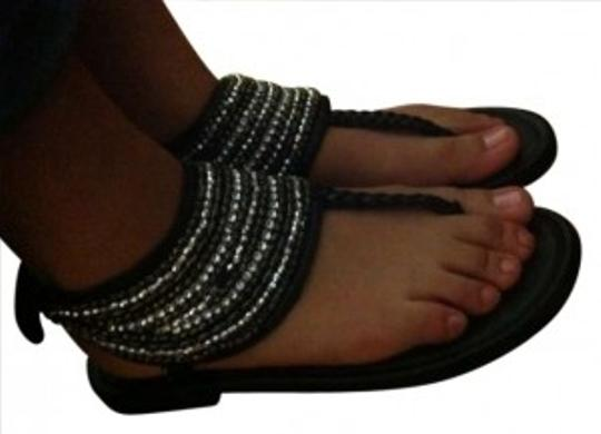 Preload https://item4.tradesy.com/images/justice-black-sandals-size-us-8-189443-0-0.jpg?width=440&height=440