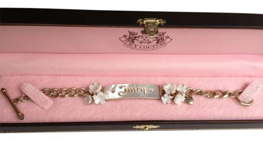 Preload https://img-static.tradesy.com/item/189508/juicy-couture-brass-and-white-mother-of-pearl-flowers-bracelet-0-0-540-540.jpg