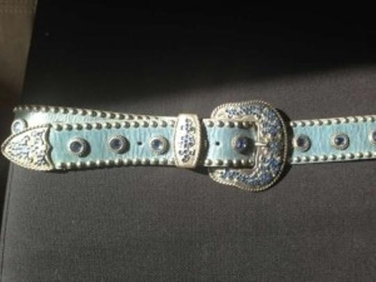 Leatherock Belt-decadently embellished leather strap, underscored by light blue Swarovski encrusted buckle.