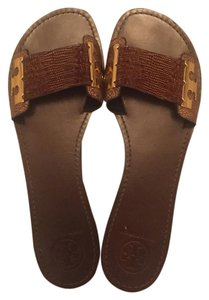 Tory Burch Brown with gold hardware Sandals