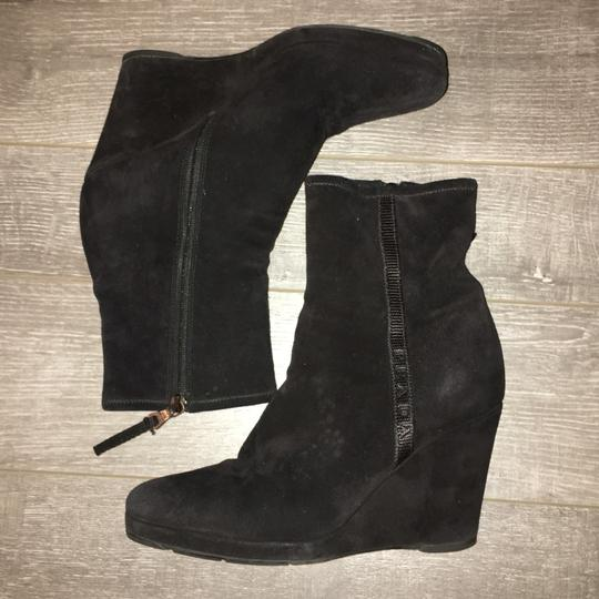 Excellent Condition ... Worn 2 times and clean inside and out. Prada fabric line across the side. Black Boots