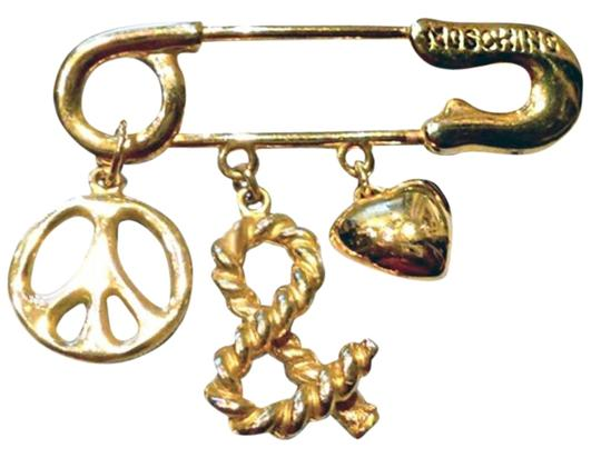 Preload https://item2.tradesy.com/images/moschino-gold-peace-and-love-tone-safety-pin-brooch-1990-s-18973486-0-1.jpg?width=440&height=440