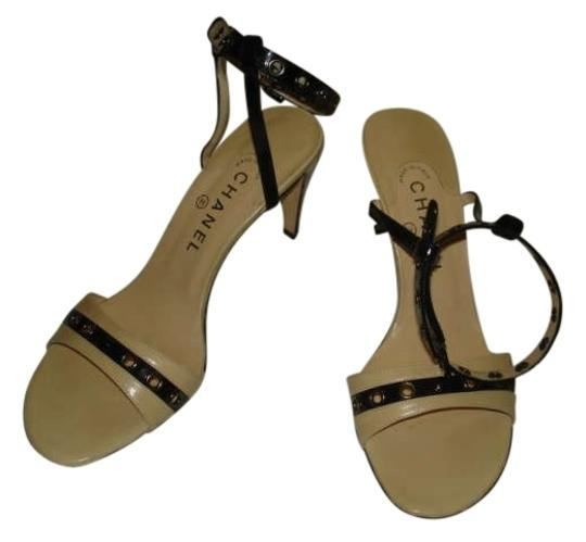 Preload https://item3.tradesy.com/images/chanel-black-and-tan-slingbacks-sandals-size-us-8-189752-0-0.jpg?width=440&height=440