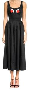 Black with red and whitel applique. Maxi Dress by Cynthia Rowley