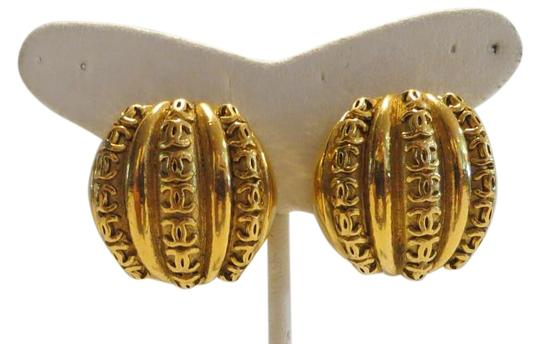 Preload https://item5.tradesy.com/images/chanel-gold-tone-vintage-clip-on-with-rows-of-cc-logo-23-earrings-18990874-0-1.jpg?width=440&height=440