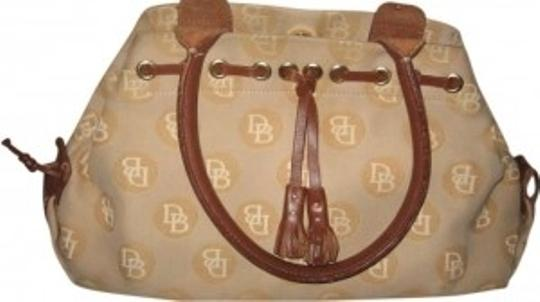 Preload https://item2.tradesy.com/images/dooney-and-bourke-beige-canvasleather-clutch-190226-0-0.jpg?width=440&height=440