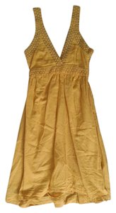 H&M short dress Mustard on Tradesy
