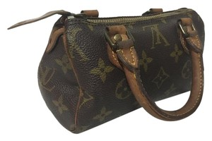 Louis Vuitton Vintage Leather Mini Brown and tan monogram Clutch