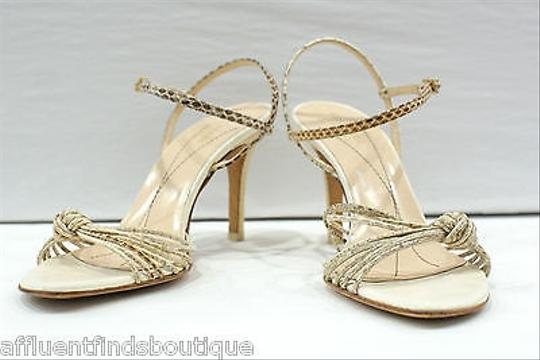 Preload https://item2.tradesy.com/images/kate-spade-strappy-ivory-tan-pumps-1902666-0-0.jpg?width=440&height=440