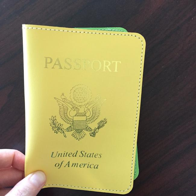 Item - Yellow Leather Embossed Passport Cover