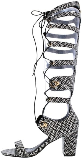 Preload https://img-static.tradesy.com/item/19084534/black-and-white-aztec-print-heel-laceup-zip-gladiator-boots-sandals-size-us-65-regular-m-b-0-1-540-540.jpg