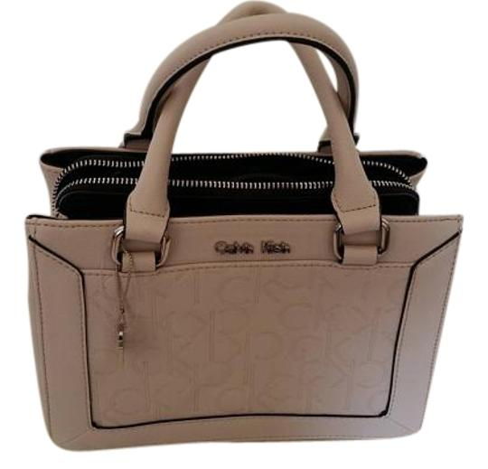 Preload https://item2.tradesy.com/images/calvin-klein-womens-sadie-studio-center-zip-carry-all-teaberry-faux-leather-tote-19084546-0-2.jpg?width=440&height=440
