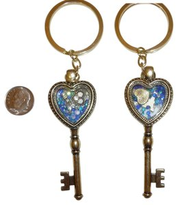 Gold Tone Heart Shaped Key Displaying a Heart and Beads