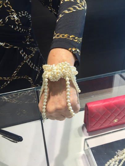Chanel CHANEL NWT WHITE FAUX PEARL KNOT BRACELET (ORIG $1675)