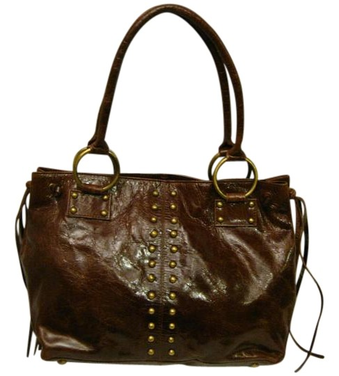 Preload https://item1.tradesy.com/images/distressed-purse-gold-grommets-and-tassles-brown-leather-tote-19104175-0-2.jpg?width=440&height=440