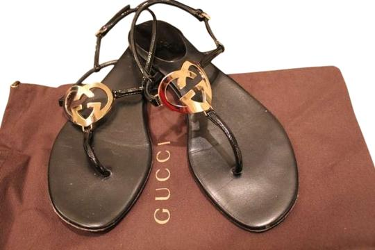 Preload https://item5.tradesy.com/images/gucci-black-thong-with-heart-shaped-interlocking-g-ornament-260960-a9l00-9905-flats-size-us-75-191114-0-1.jpg?width=440&height=440