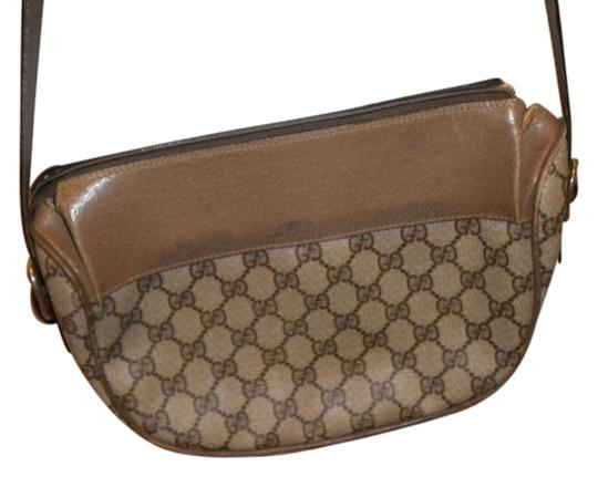 Preload https://item2.tradesy.com/images/gucci-no-taupebrown-leather-and-vinyl-in-places-shoulder-bag-19112776-0-1.jpg?width=440&height=440