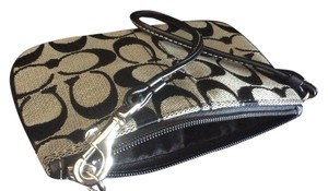 Coach Excellent Wristlet in Brown and beige
