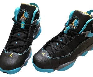 Jordan Nikes Jordans black with sky blue and yellow/grey accents Athletic