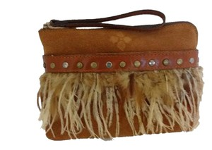 Patricia Nash Designs Genuine suede feather trim on front of slip pocket