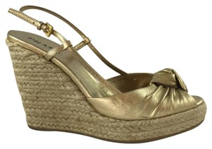 Prada Gold Wedges