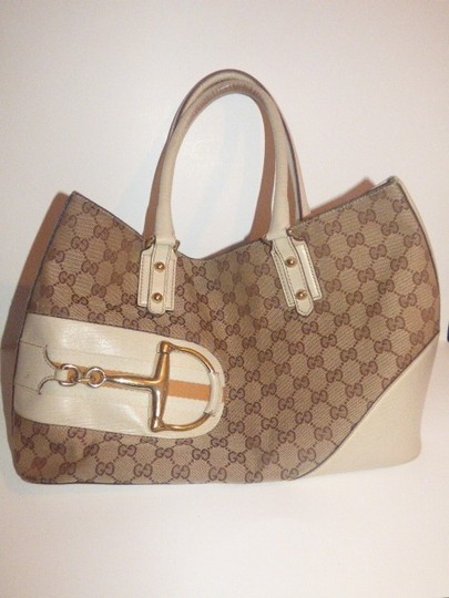 Gucci Satchel/Tote Style Excellent Vintage Equestrian Bold Gold Horsebit Style Satchel in brown large logo print canvas, yellow accent, white leather Image 1