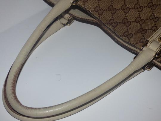 Gucci Satchel/Tote Style Excellent Vintage Equestrian Bold Gold Horsebit Style Satchel in brown large logo print canvas, yellow accent, white leather Image 11