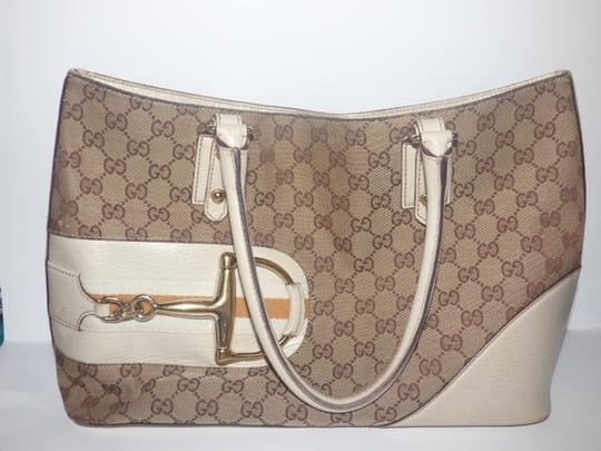 Gucci Satchel/Tote Style Excellent Vintage Equestrian Bold Gold Horsebit Style Satchel in brown large logo print canvas, yellow accent, white leather Image 3