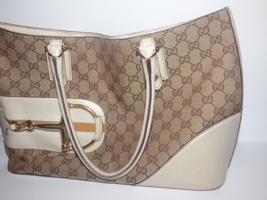 Gucci Satchel/Tote Style Excellent Vintage Equestrian Bold Gold Horsebit Style Satchel in brown large logo print canvas, yellow accent, white leather Image 5