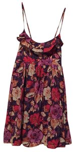 Xhilaration short dress Purple with all over floral print Spaghetti Stap on Tradesy
