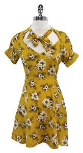 What Comes Around Goes Around short dress Yellow Floral Silk on Tradesy