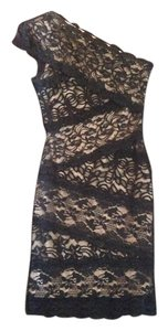 bebe short dress Black lace with nude colored lining on Tradesy