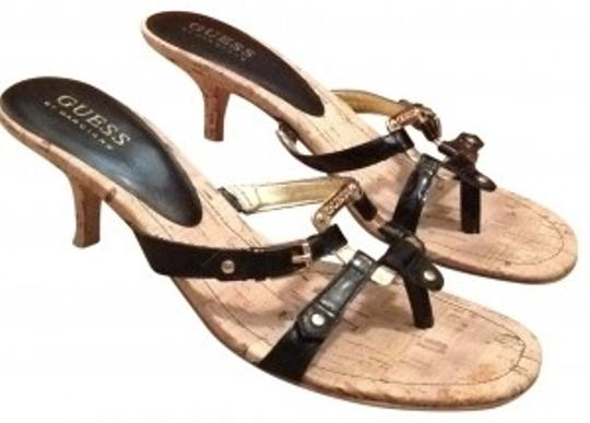 Preload https://item3.tradesy.com/images/guess-black-and-gold-sandals-size-us-7-regular-m-b-191872-0-0.jpg?width=440&height=440