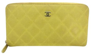 Chanel Classic Quilted Zip Around Yellow Clutch