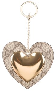 Gucci Brown, Gold GG coated canvas Gucci heart kechain bag charm