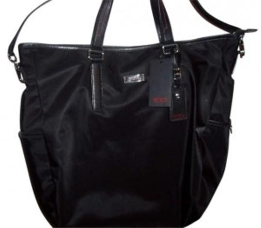 Preload https://item3.tradesy.com/images/tumi-black-nylon-with-leather-trim-and-rylon-lining-hobo-bag-192357-0-0.jpg?width=440&height=440