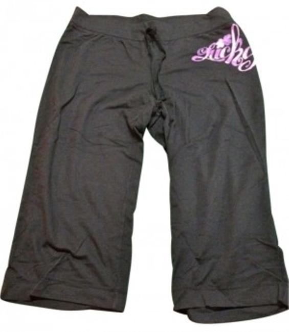 Preload https://item2.tradesy.com/images/lucky-brand-black-with-pinkpurple-graphic-capris-size-10-m-31-192396-0-0.jpg?width=400&height=650
