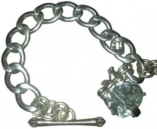 Preload https://item5.tradesy.com/images/juicy-couture-silver-starter-charm-bracelet-192459-0-0.jpg?width=440&height=440