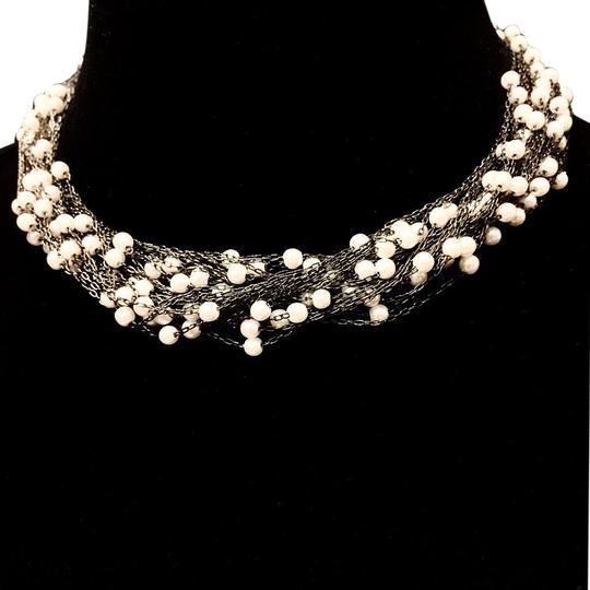 Preload https://img-static.tradesy.com/item/19254925/black-multi-strand-faux-pearl-and-iron-necklace-0-1-540-540.jpg