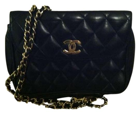Preload https://item5.tradesy.com/images/chanel-black-and-gold-with-red-inside-lambskin-clutch-192564-0-0.jpg?width=440&height=440