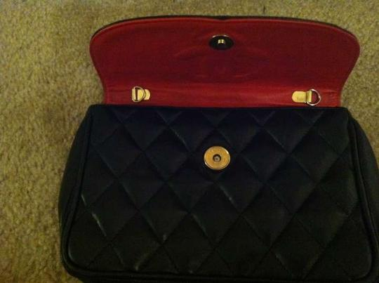 Chanel black and gold with red inside Clutch